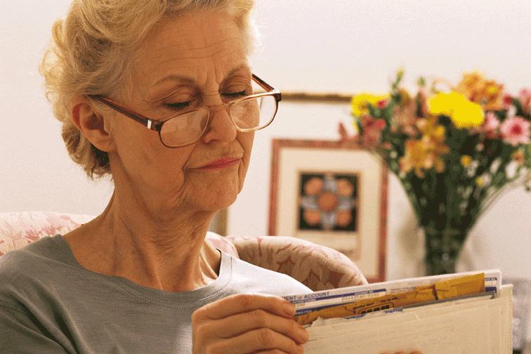Senior woman going through paperwork