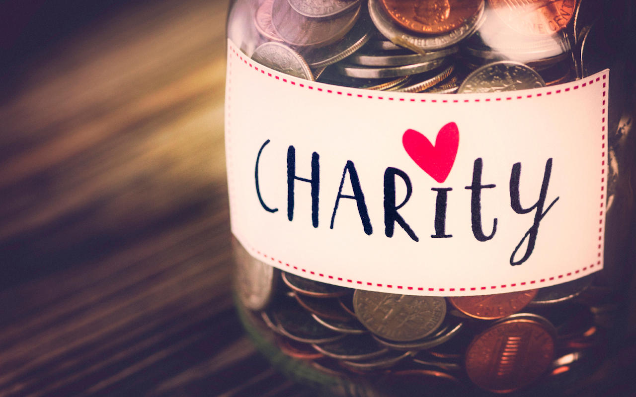 Charity labeled money jar